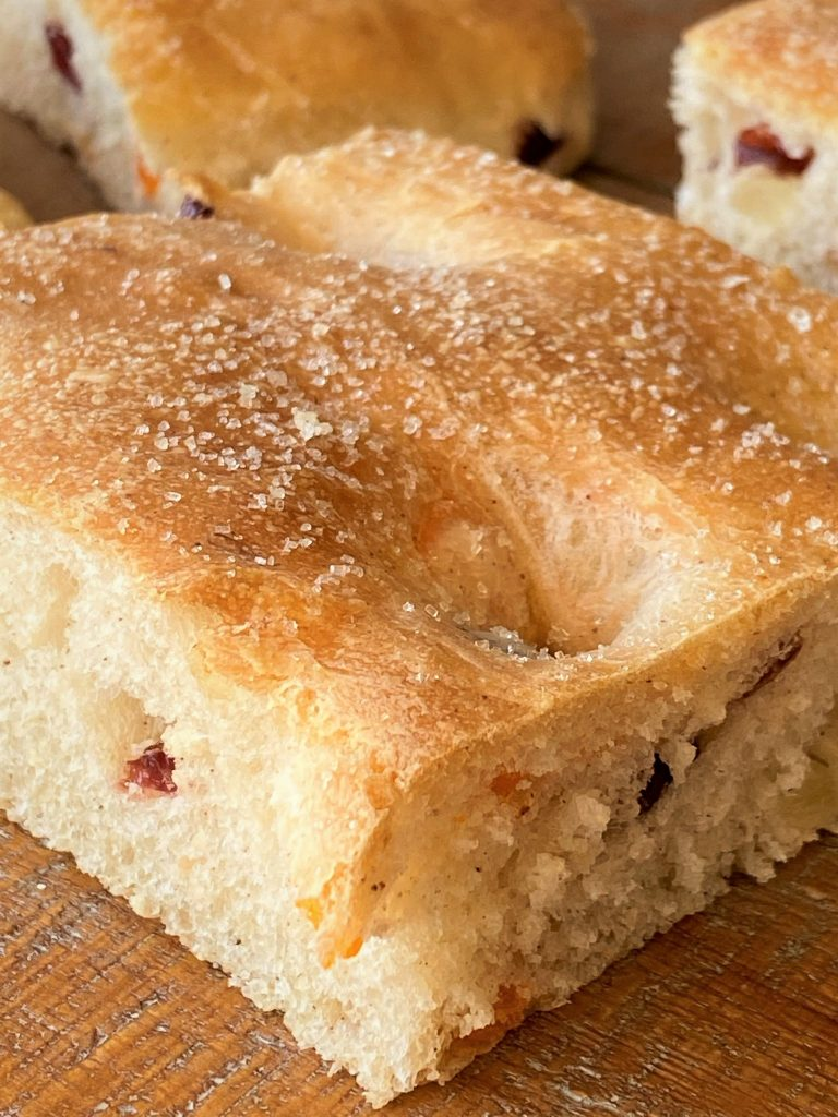 up close slice of focaccia with sugar on top