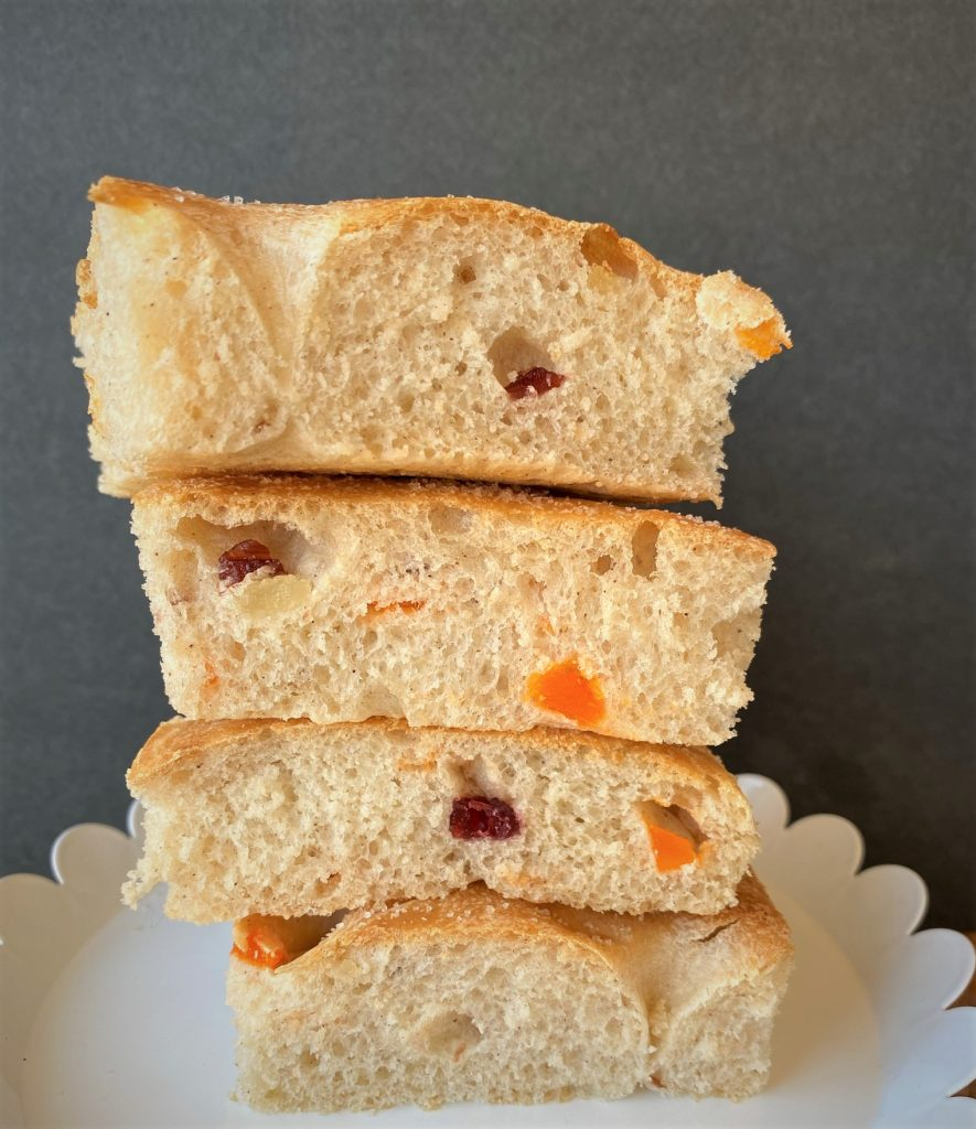 stacked sliced focaccia bread on a plate