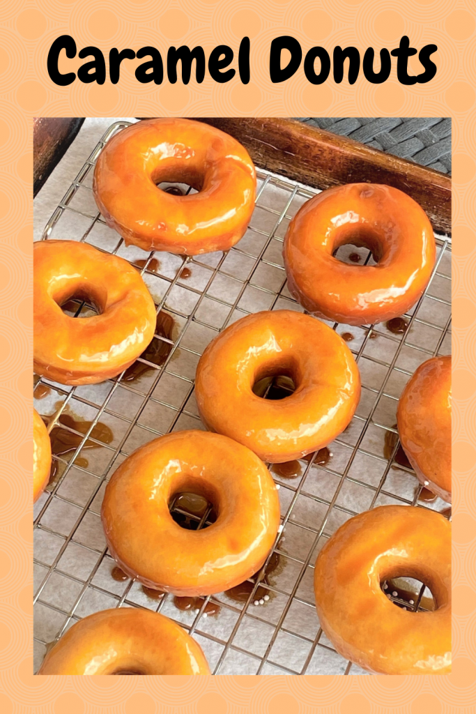 caramel donuts on a baking rack