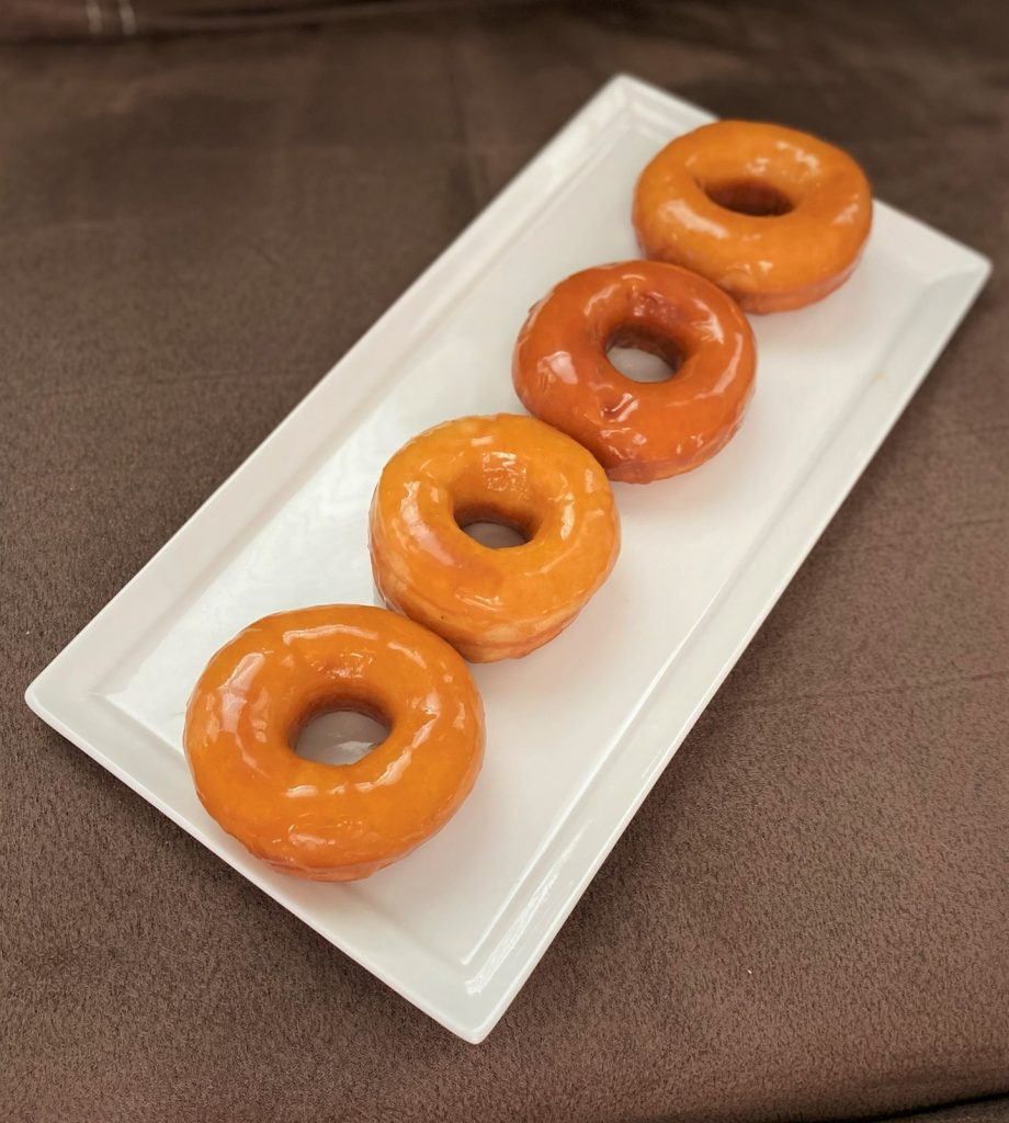 caramel donuts lined up on a plate