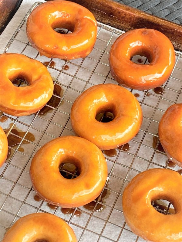caramel donuts on a sheet pan