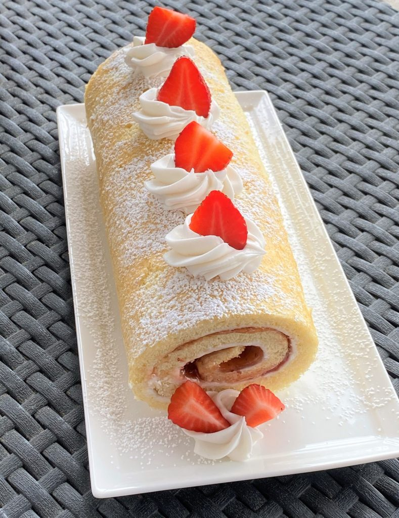 strawberry jellyroll cake on a plate