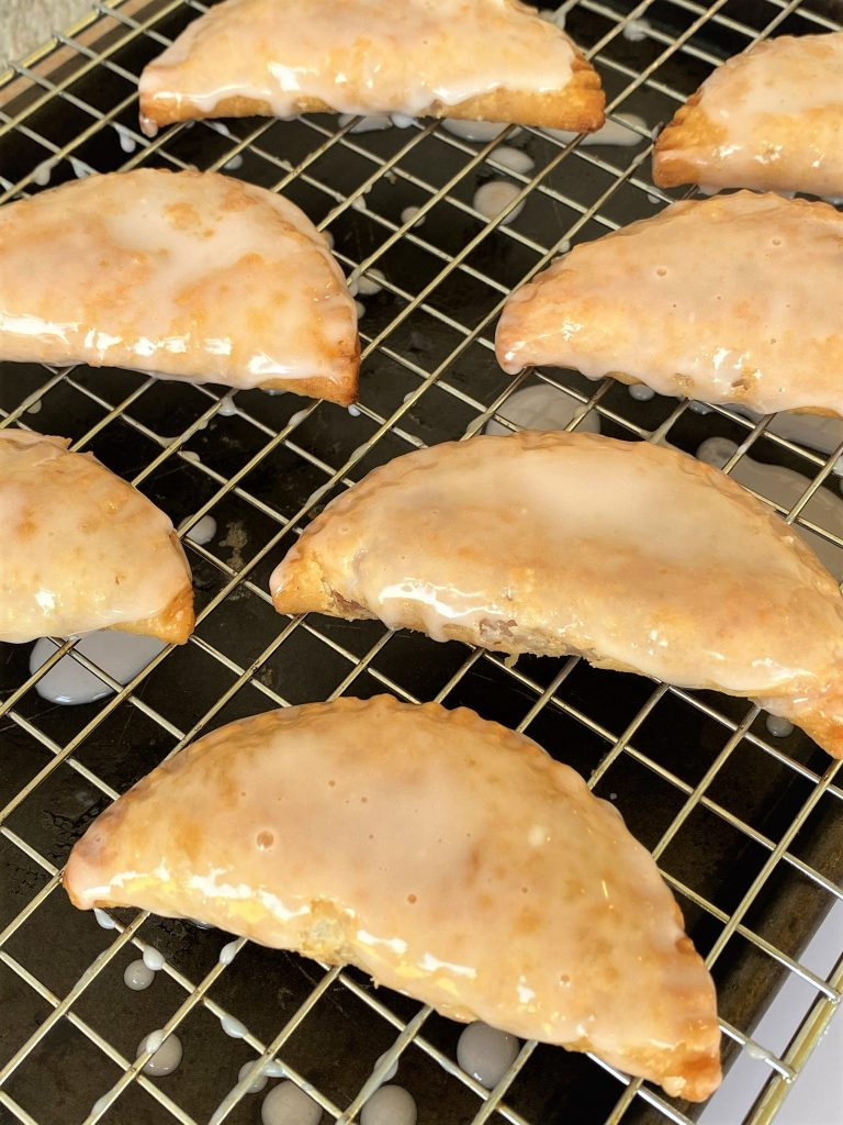 strawberry fried pies on a cooling rack