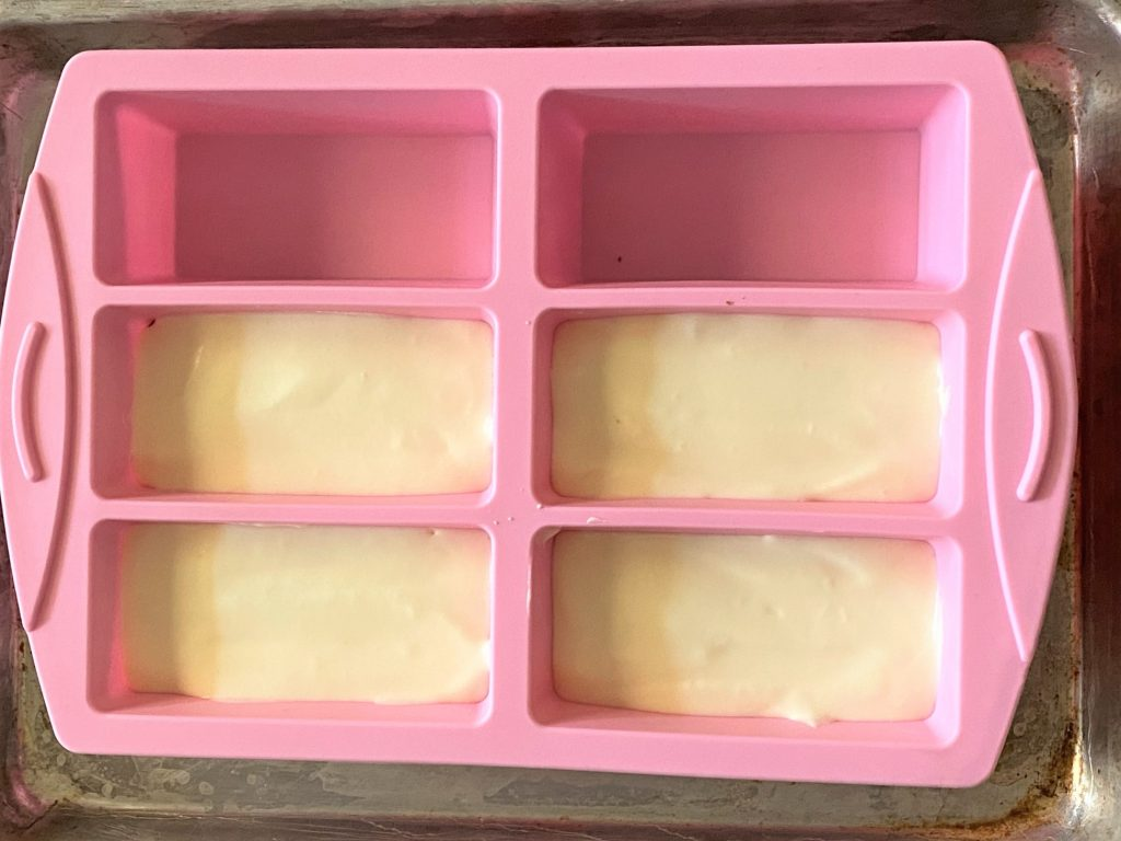 piping mousse in a silicone mold