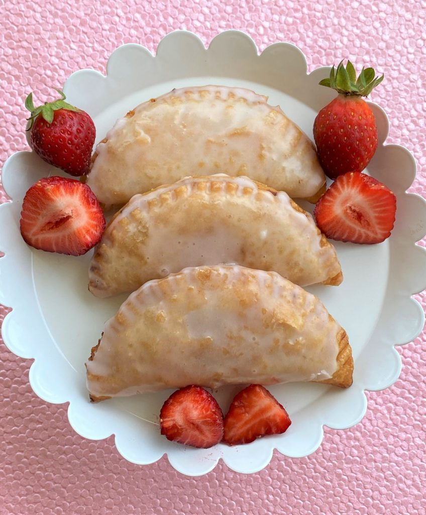 strawberry fried pies on a plate