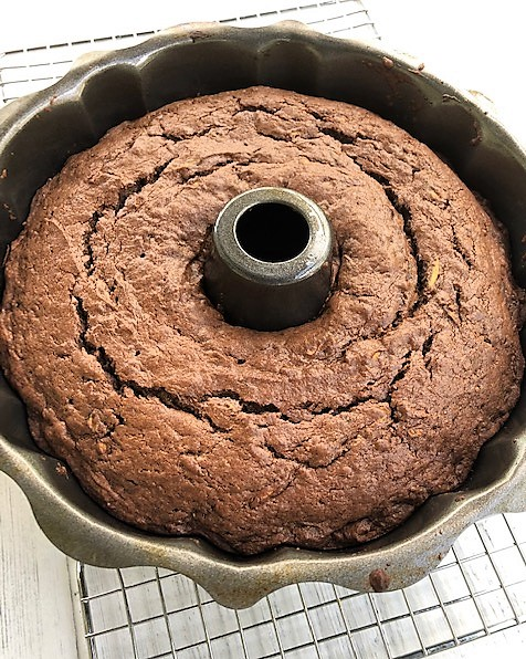 chocolate zucchini cake cooling on a rack