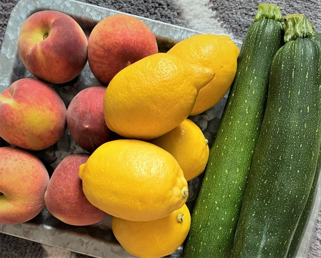 peaches zucchini and lemons on a platter