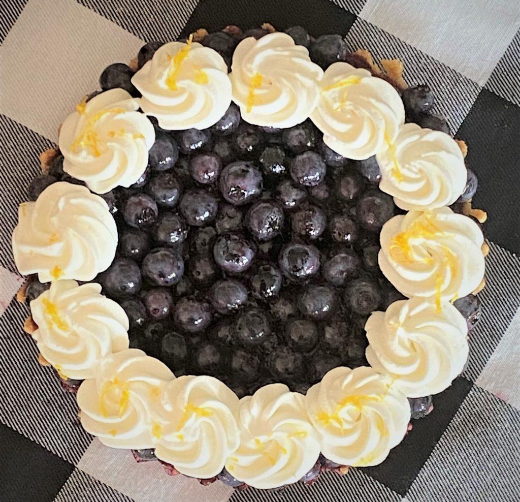 decorating lemon blueberry tart
