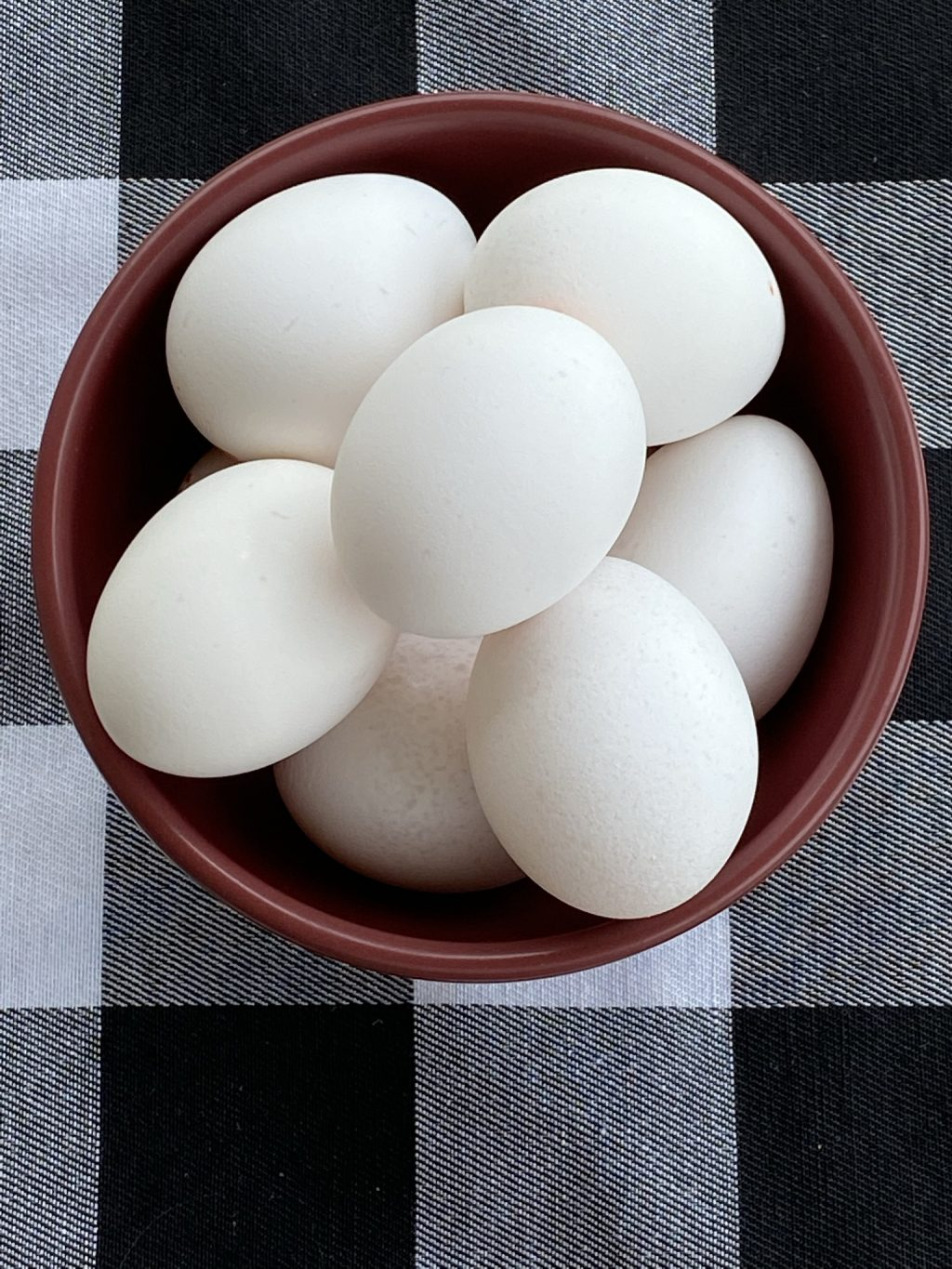 bowl of eggs on a placemat