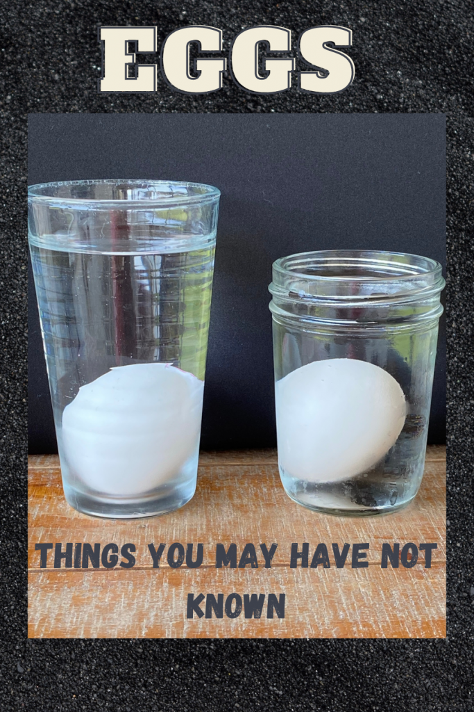 Eggs in glasses of water to test for freshness