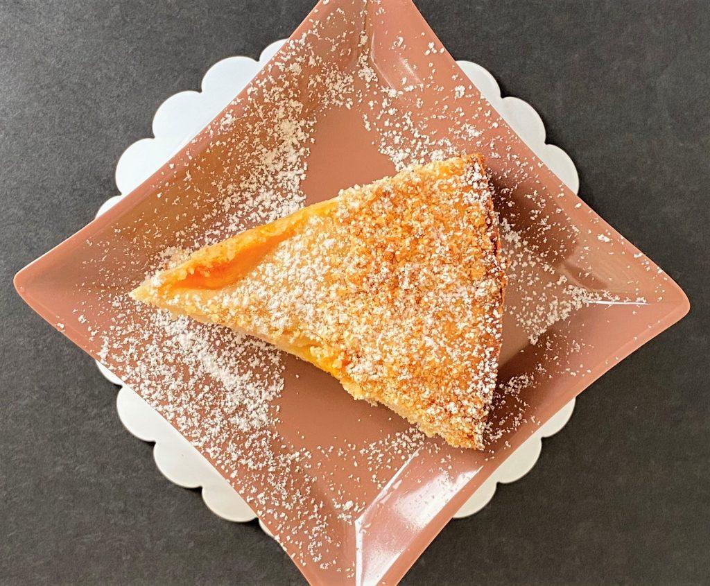 slice of peach coffee cake on a plate